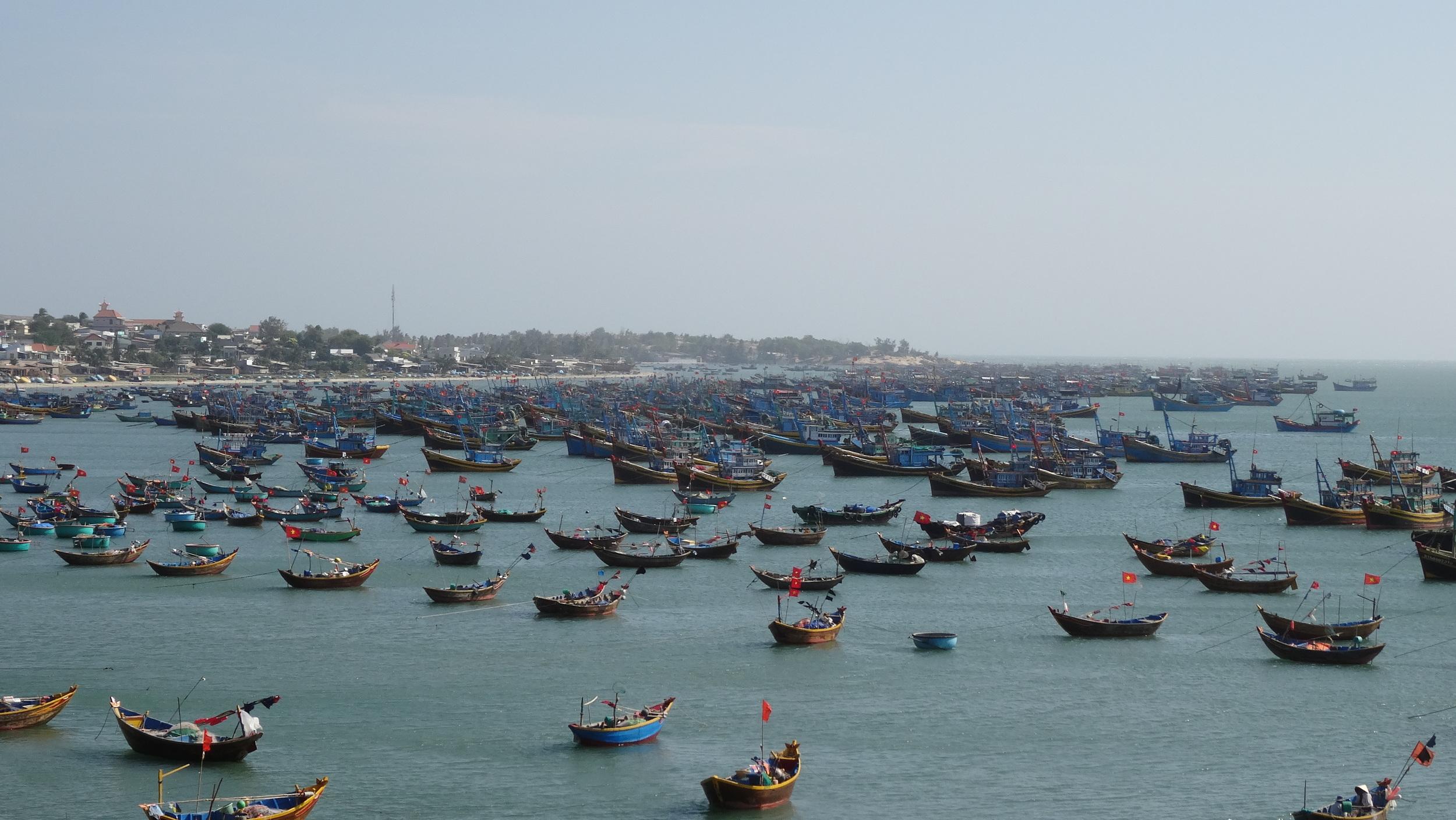 Small fishermen boats, South China Sea.