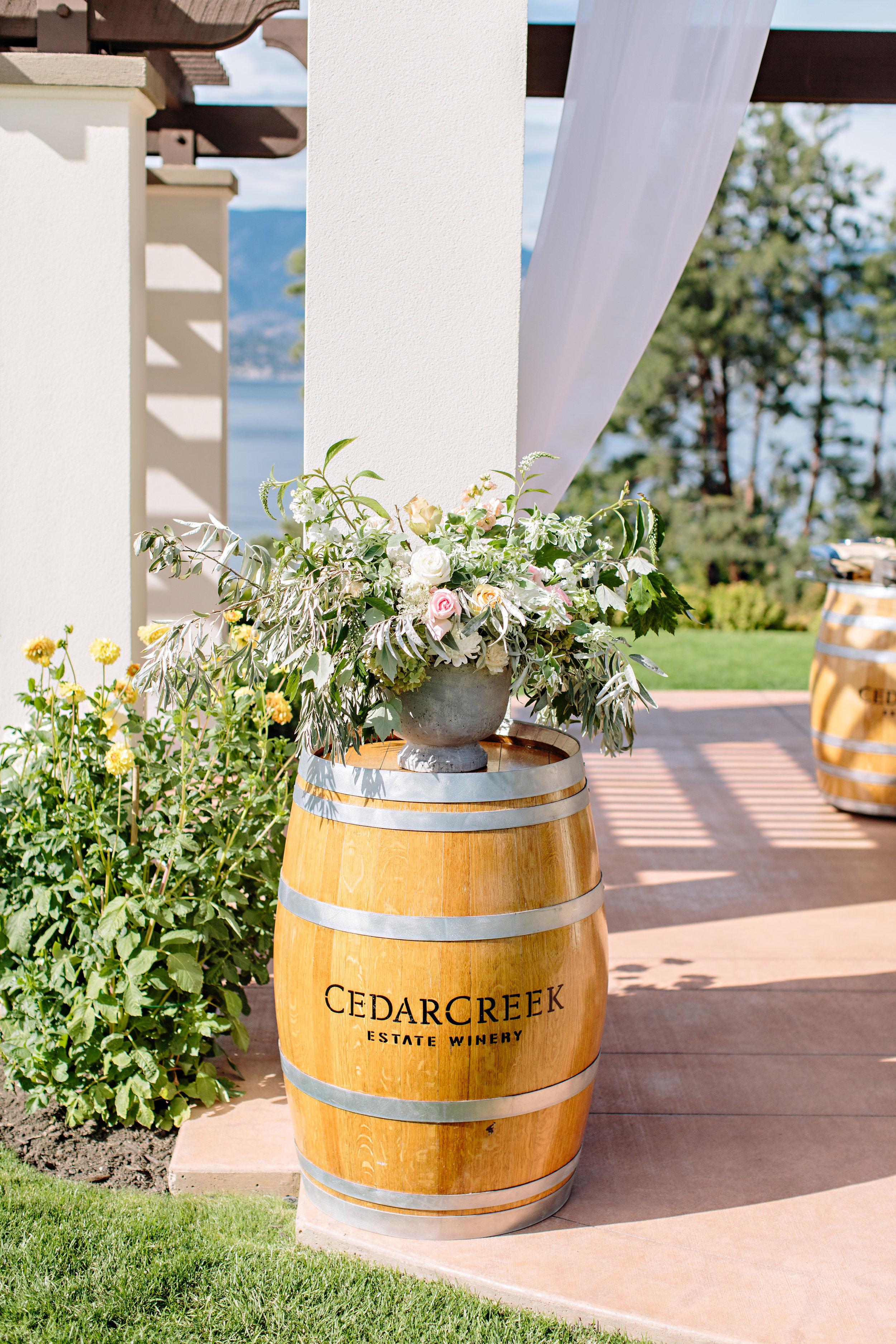 ceremony flowers wine barrel wedding decor