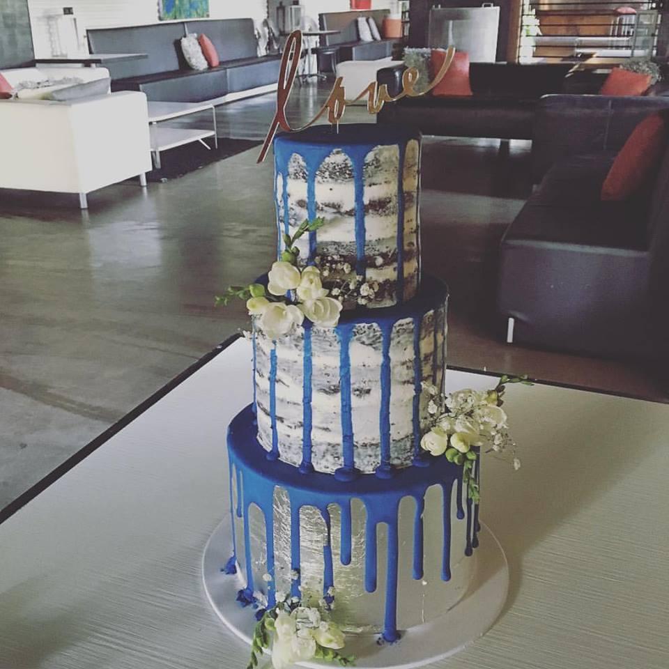Naked Wedding Cake with Dark Blue Drip