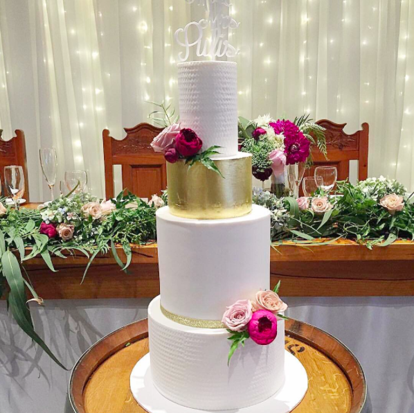 Wedding Cake with Gold Leaf & Bright Blooms