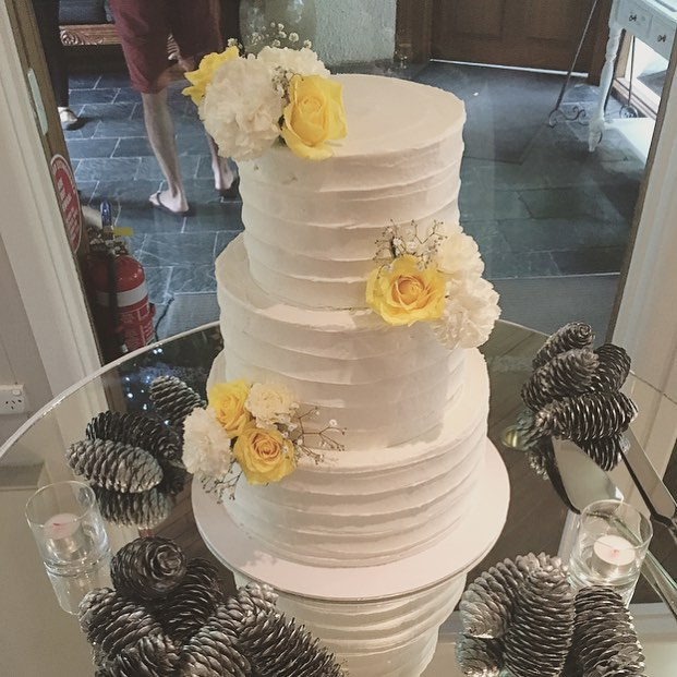 Buttercream Cake with Yellow Flowers