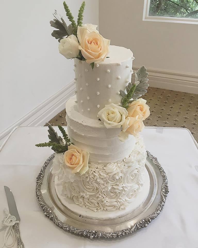 3 tier wedding cake with ruffles, dots & peach flowers