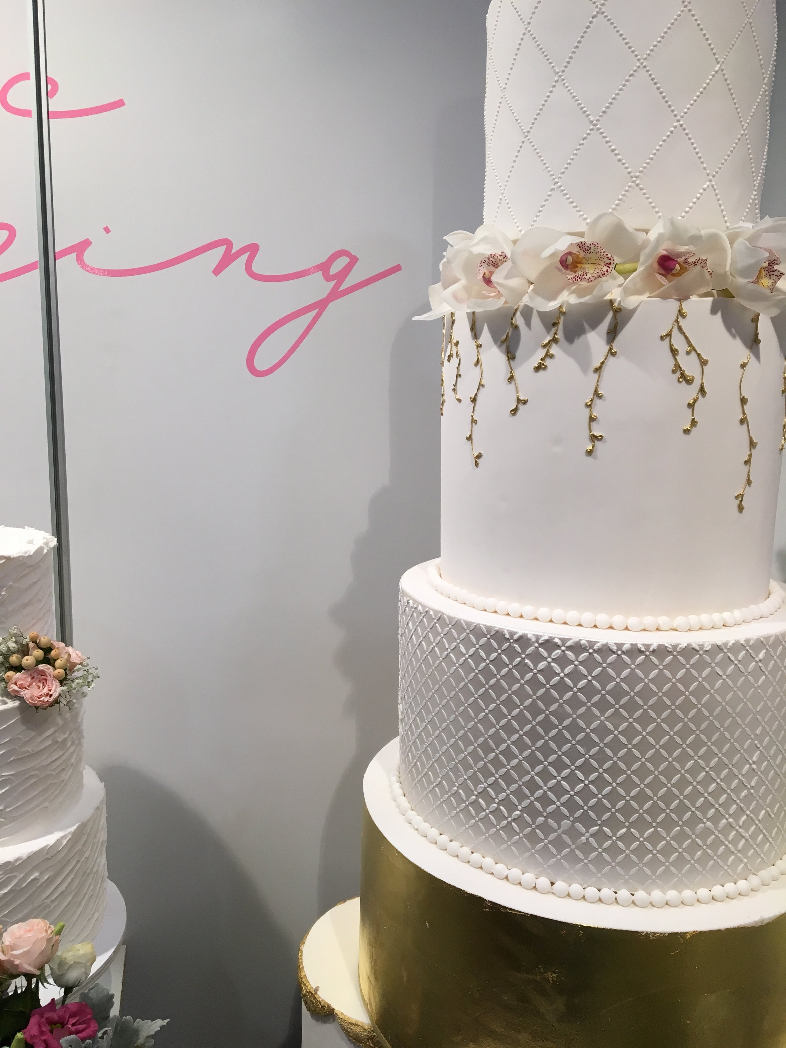 Gold & White Showstopper Wedding Cake with Orchids