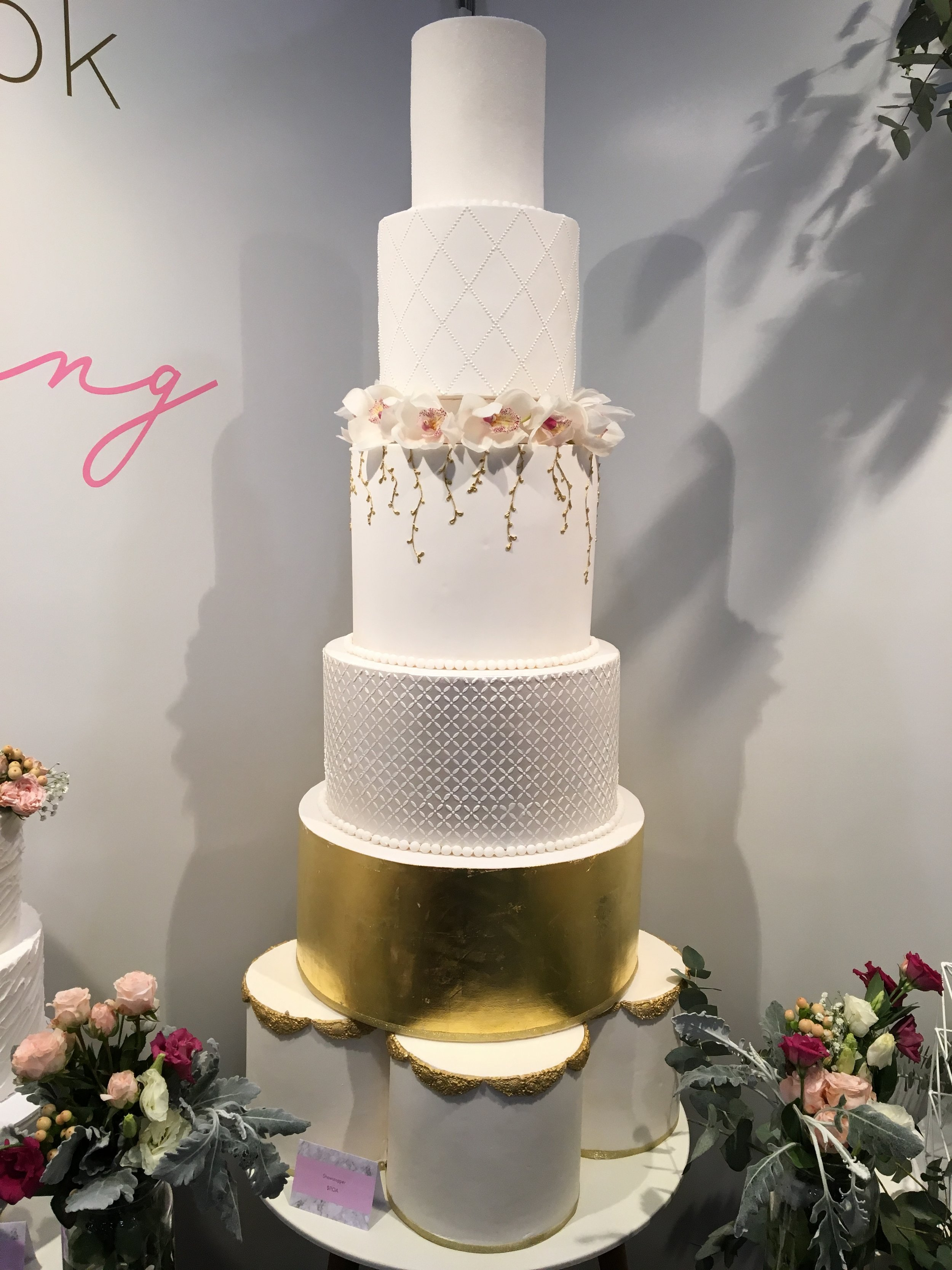 Gold & White Showstopper Wedding Cake with Flowers