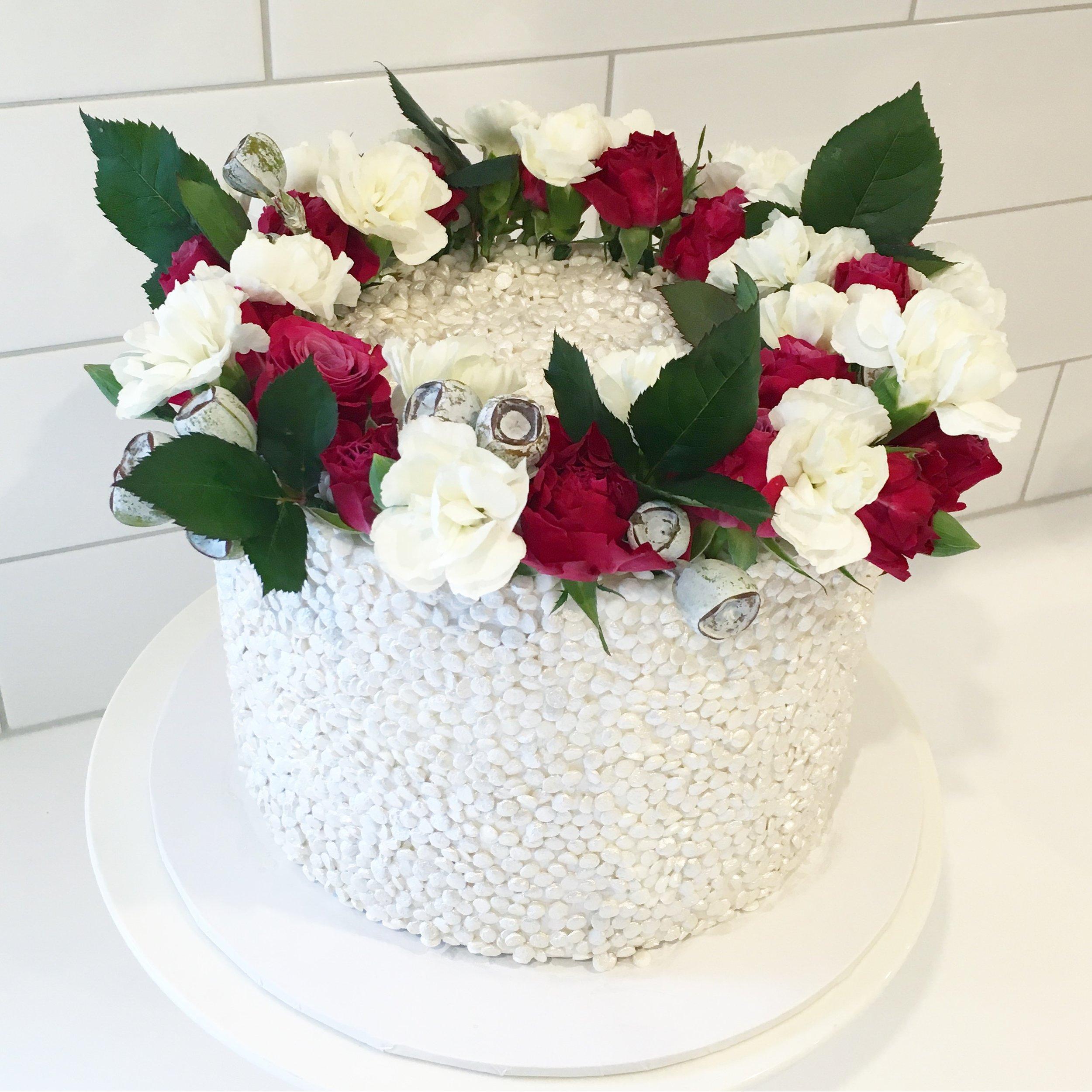 White Sequin Cake with Red Flower Halo