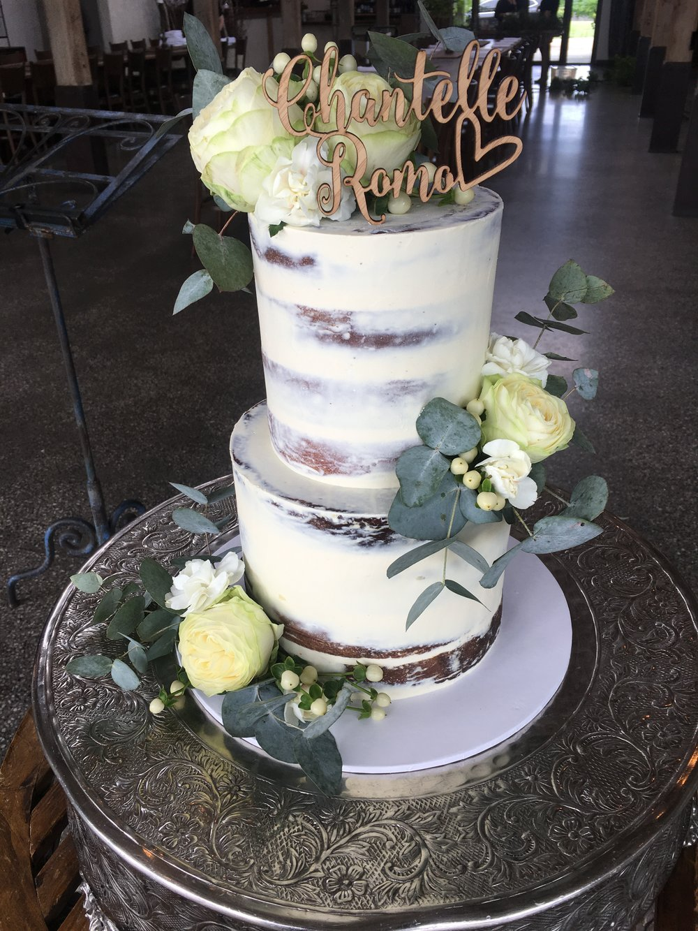 Naked cake with personalised bamboo topper