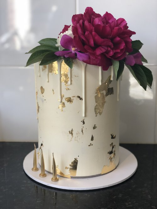 The Gold Leaf & White Drip Cake available to order now on our Online Bakeshop