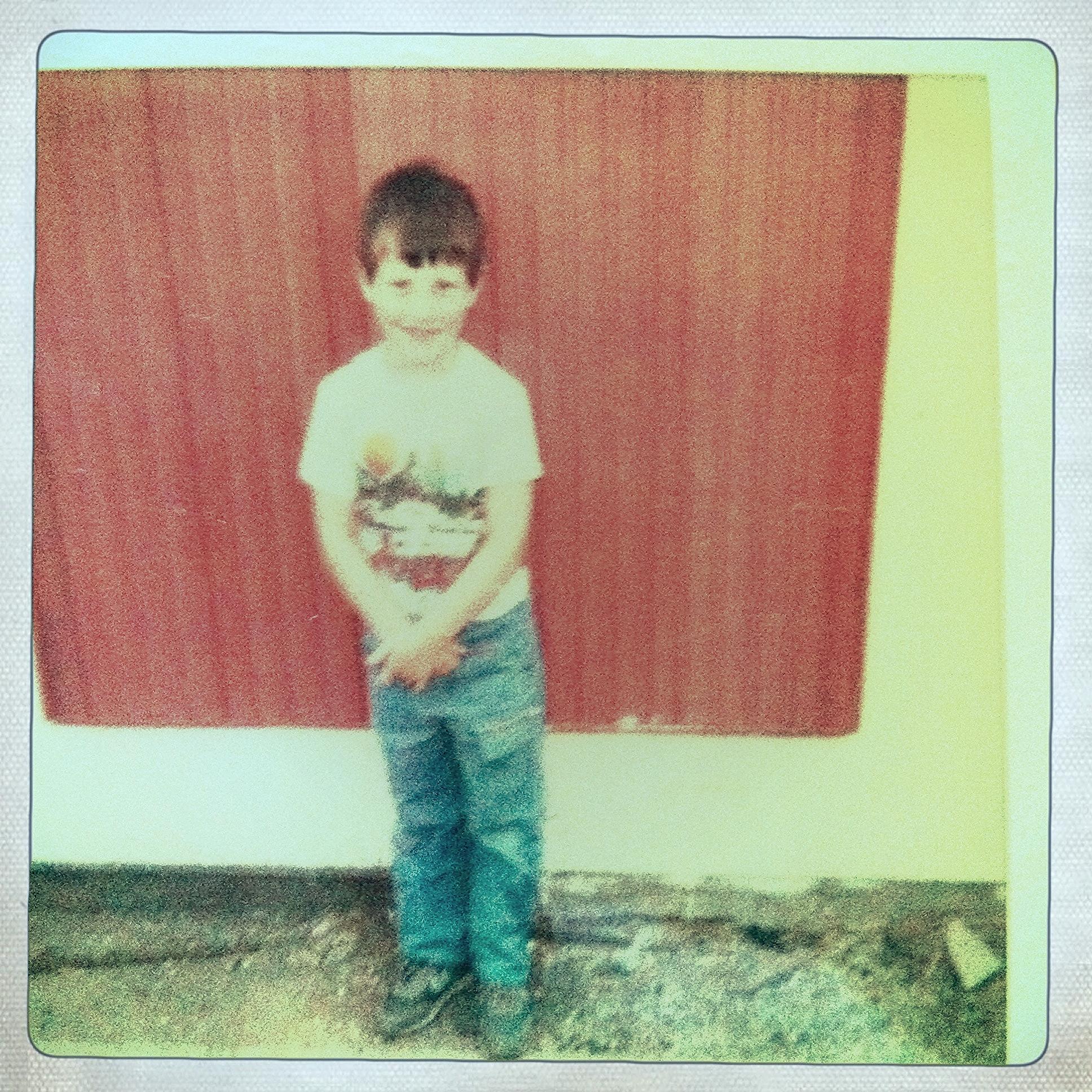 Michael,  circa 1985, the daynew baby brother, Ryan comes home