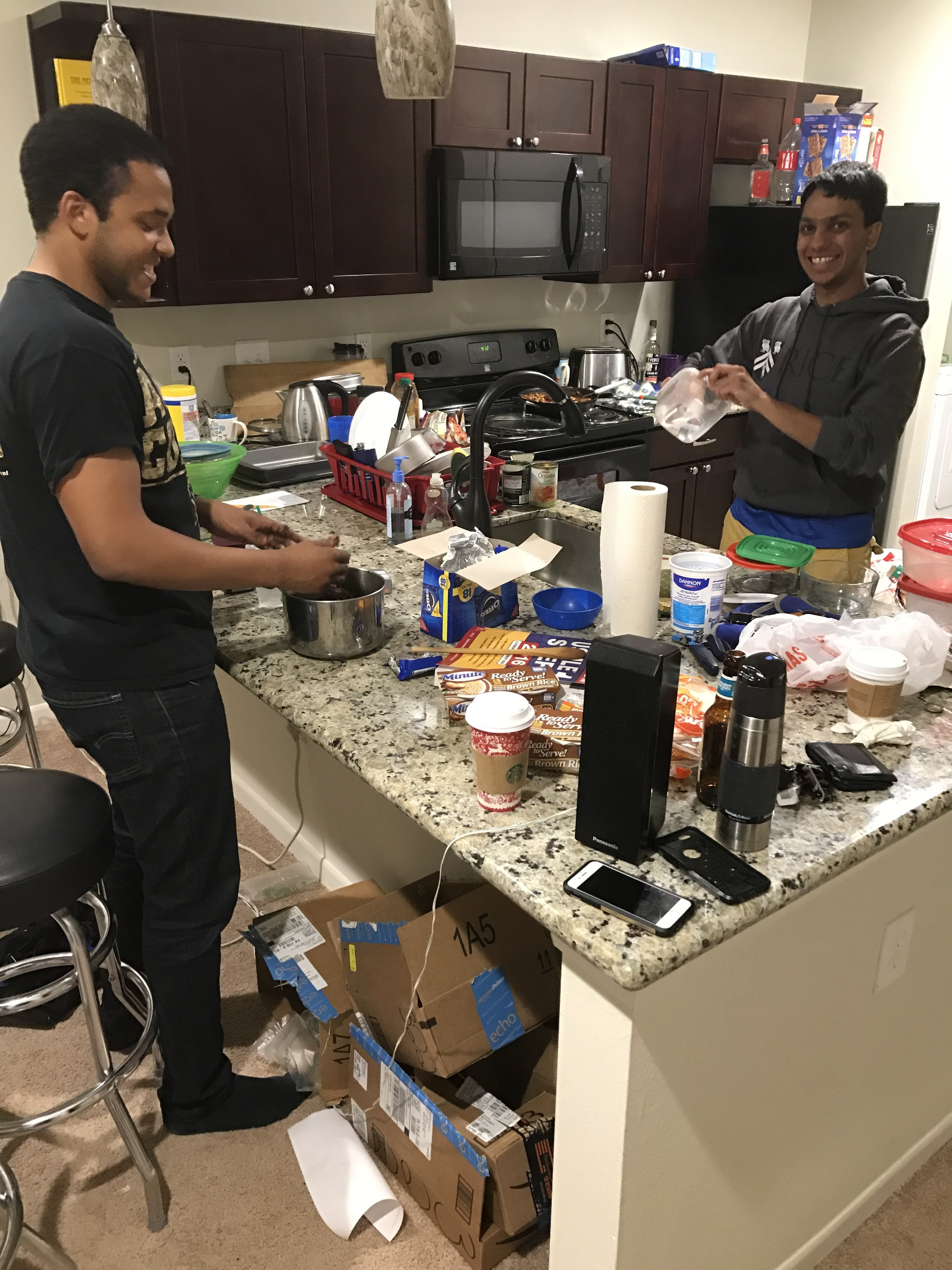 Jason Mallet (left) and Nitin Agrawal (right)preparing their meal. Photos provided by Nitin Agrawal, M1.