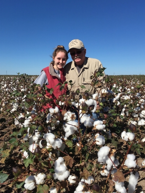 """Julie England, M2, and father, Lanny England, in their family's 2017 cotton crop in Runnels County Texas. Julie explains, """"My dad's lessons in 'farmer logic' played a big role in developing my love for medicine."""" Photo from Julie England."""