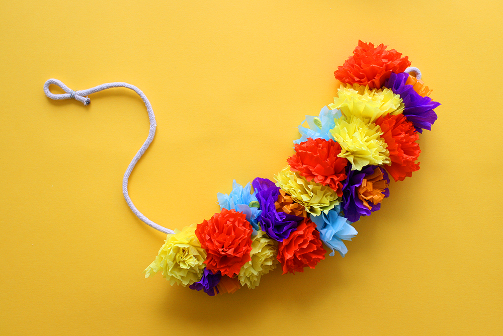 Step 16  Continue attaching flowers until you have reached your desired garland length. Then hang your garland in your favourite spot and enjoy!