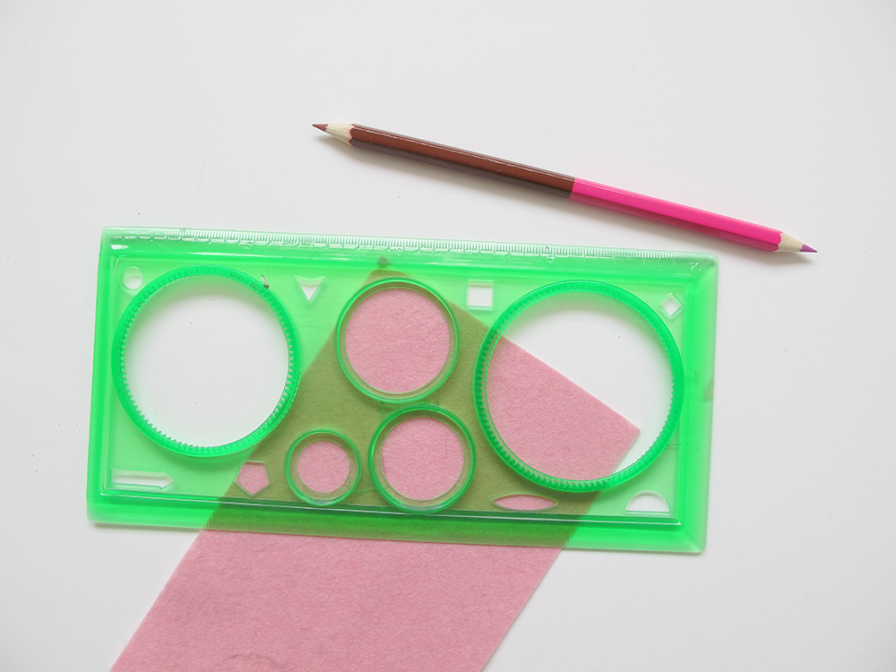 Step 1  Find something circular to use as a template (approximately 4cm in size) and draw 2 circles onto each piece of felt.