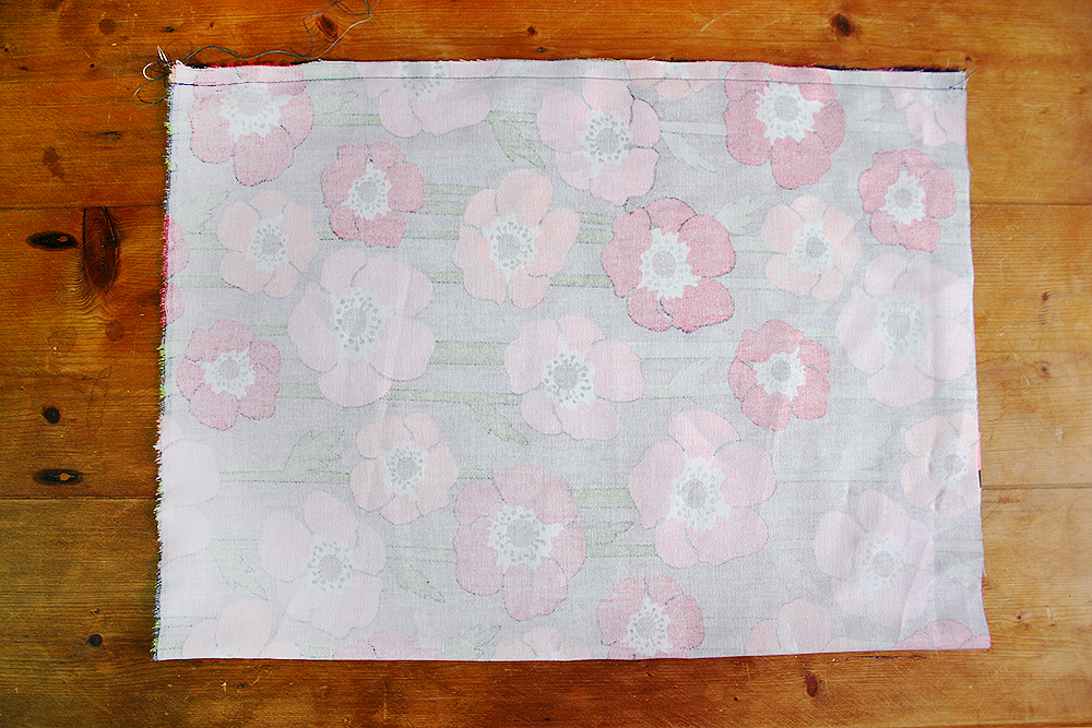 Step 4  Fold the rectangle in half with right sides facing in, and sew the short edges together (remember your 0.5cm seam allowance for this). This will form a tube.