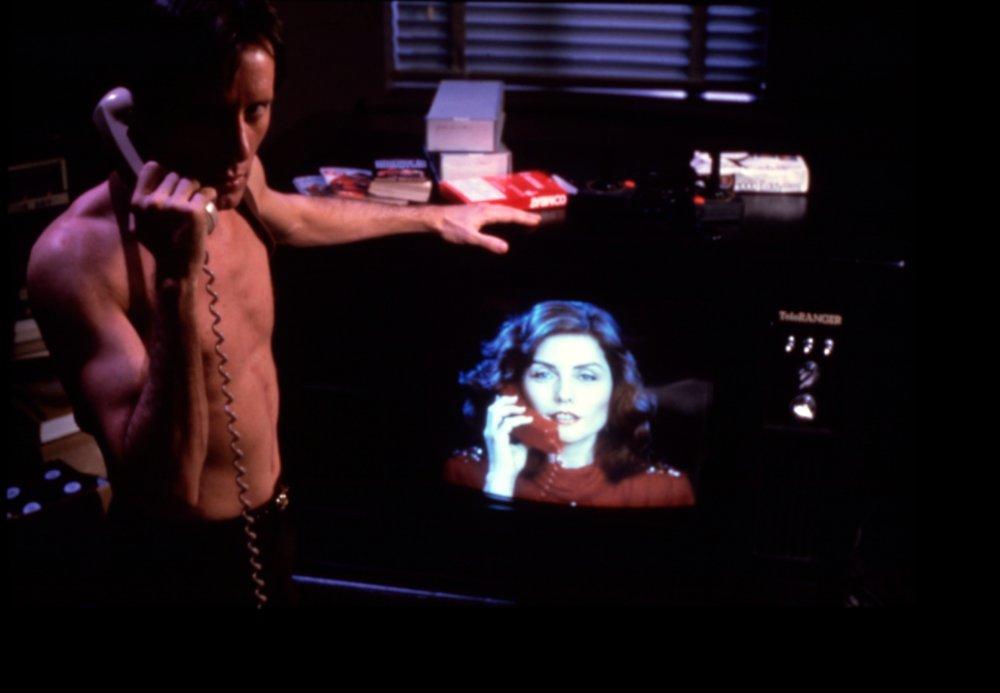 videodrome-1983-002-james-woods-on-the-phone-debbie-harry-on-tv-bfi-00o-ap3.jpg