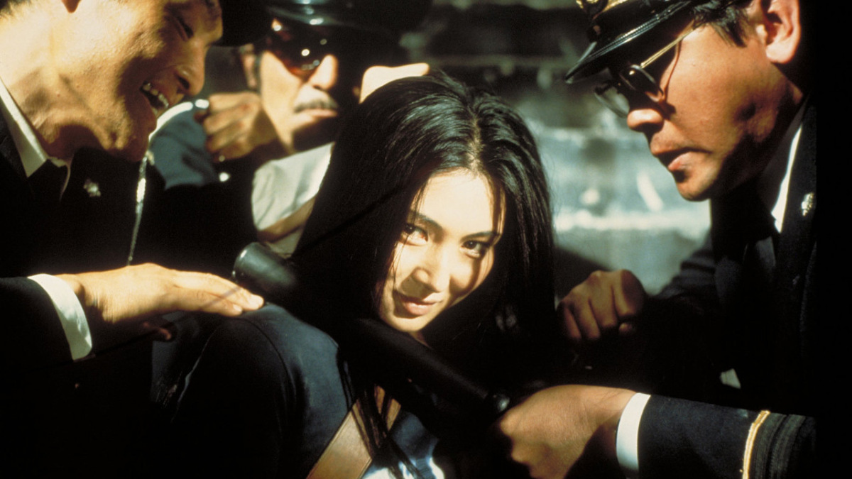 Nami/Matsu the Scorpion (Meiko Kaji) flashes a defiant grin in Shunya Ito's  Female Prisoner #701: Scorpion  (女囚701号/さそり  Joshū Nana-maru-ichi Gō / Sasori ).