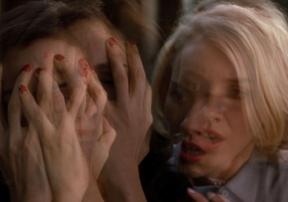 Mulholland Drive 's multiples; the superimposition is visual shorthand for a ruptured psyche/fragmented self.