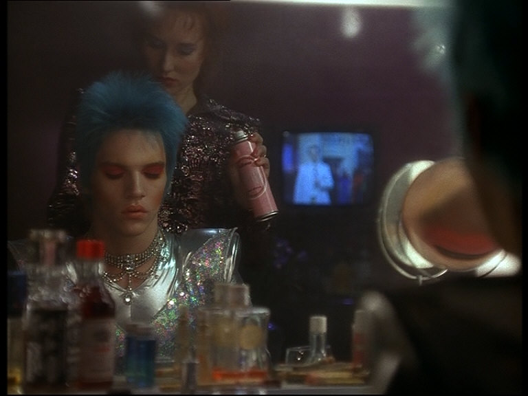 "Everyone's Obsessed With Brian Slade In Velvet Goldmine - by Danielle Ryan""The ever-changing Slade shifts his obsessions as regularly as he does his colorful costumes. His infatuation with Mandy fades, and he becomes obsessed instead with Wild. He's never truly in love with them, however, as much as he is in love with the idea of them. He basks in their adoration and soaks up their attention because it comforts him. As vain and narcissistic as Slade may be, he's also incredibly insecure in his love for himself. Surrounding himself with people who are likewise enchanted with his persona allows him to indulge his more selfish whims. He takes what he needs from his lovers…"""