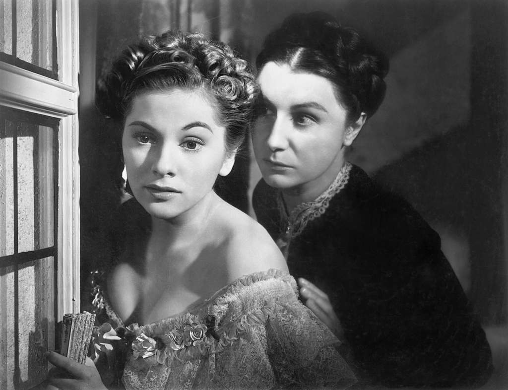 The second Mrs. de Winter (Joan Fontaine) and the intimidating Mrs. Danvers (Judith Anderson) in Alfred Hitchcock's  Rebecca  (1940).