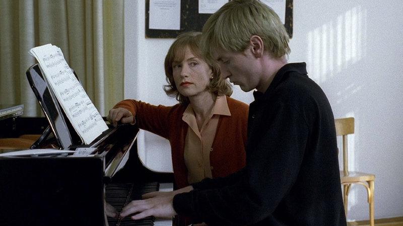 Erika (Isabelle Huppert) eyes her newest pupil, Walter (Benoît Magimel) in Michael Haneke's  The Piano Teacher  ( La Pianiste,  2001).