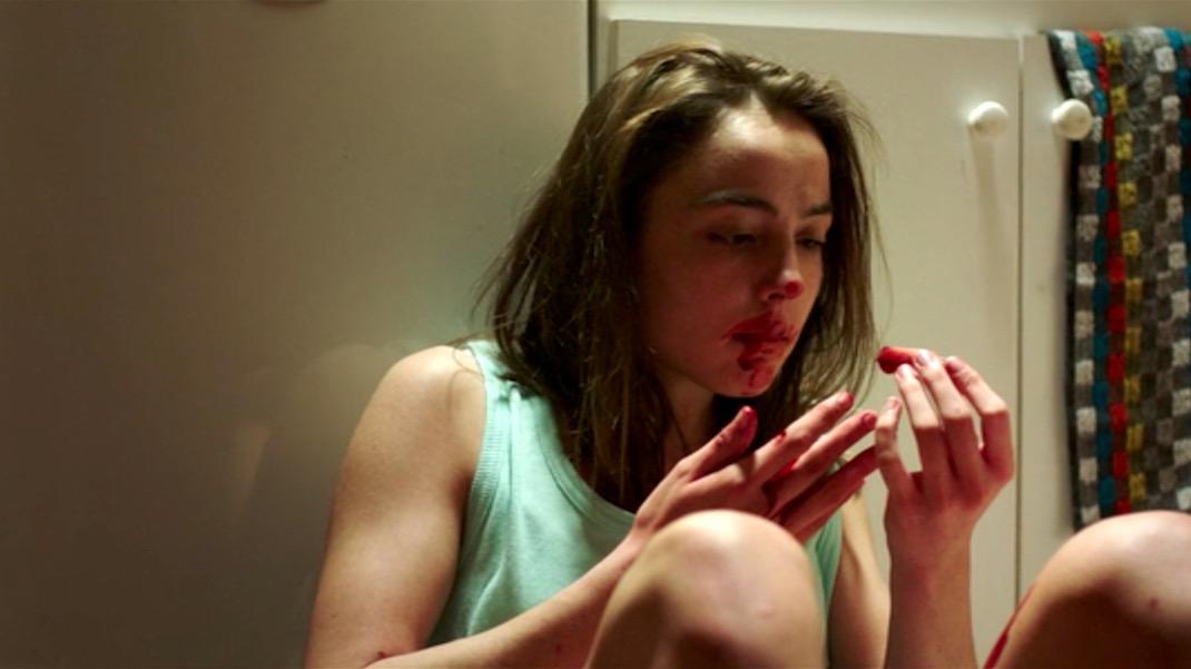 Justine (Garance Marillier) satisfies her cravings in Julia Ducournau's  Raw  ( Grave , 2016).