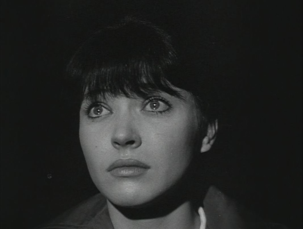 Nana (Anna Karina) is moved during a screening of  La Passion de Jeanne d'Arc    in Godard's  Vivre Sa Vie: film en douze tableaux  (1963).