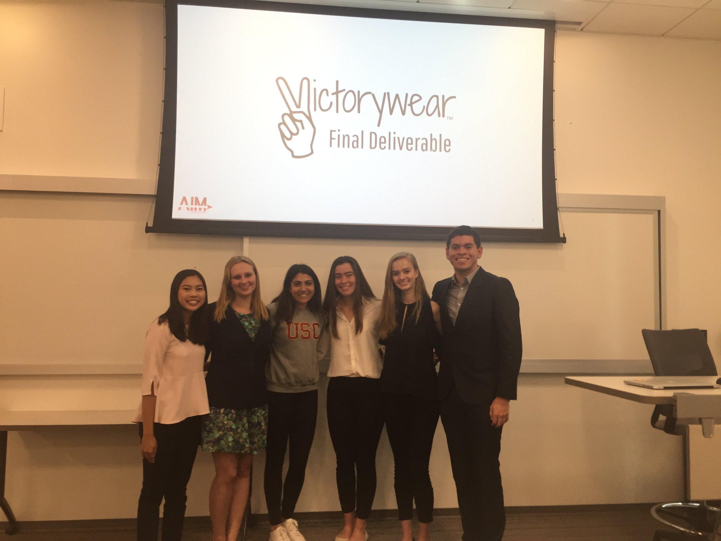 Consultants presenting to the founder of Victorywear. (L-R: Dani Toda, Emily Moneymaker, Victorywear representative, Emily Heuring, Emma Hunter, Josh Hunt).