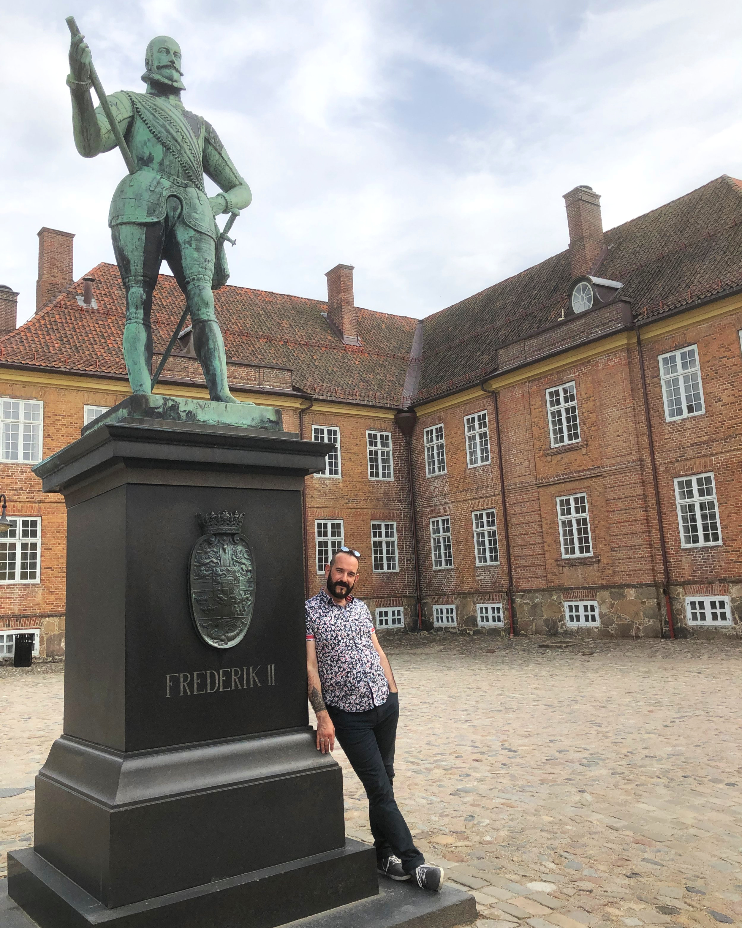 Mathew with a statue of Frederik II at Fredrikstad, Norway.