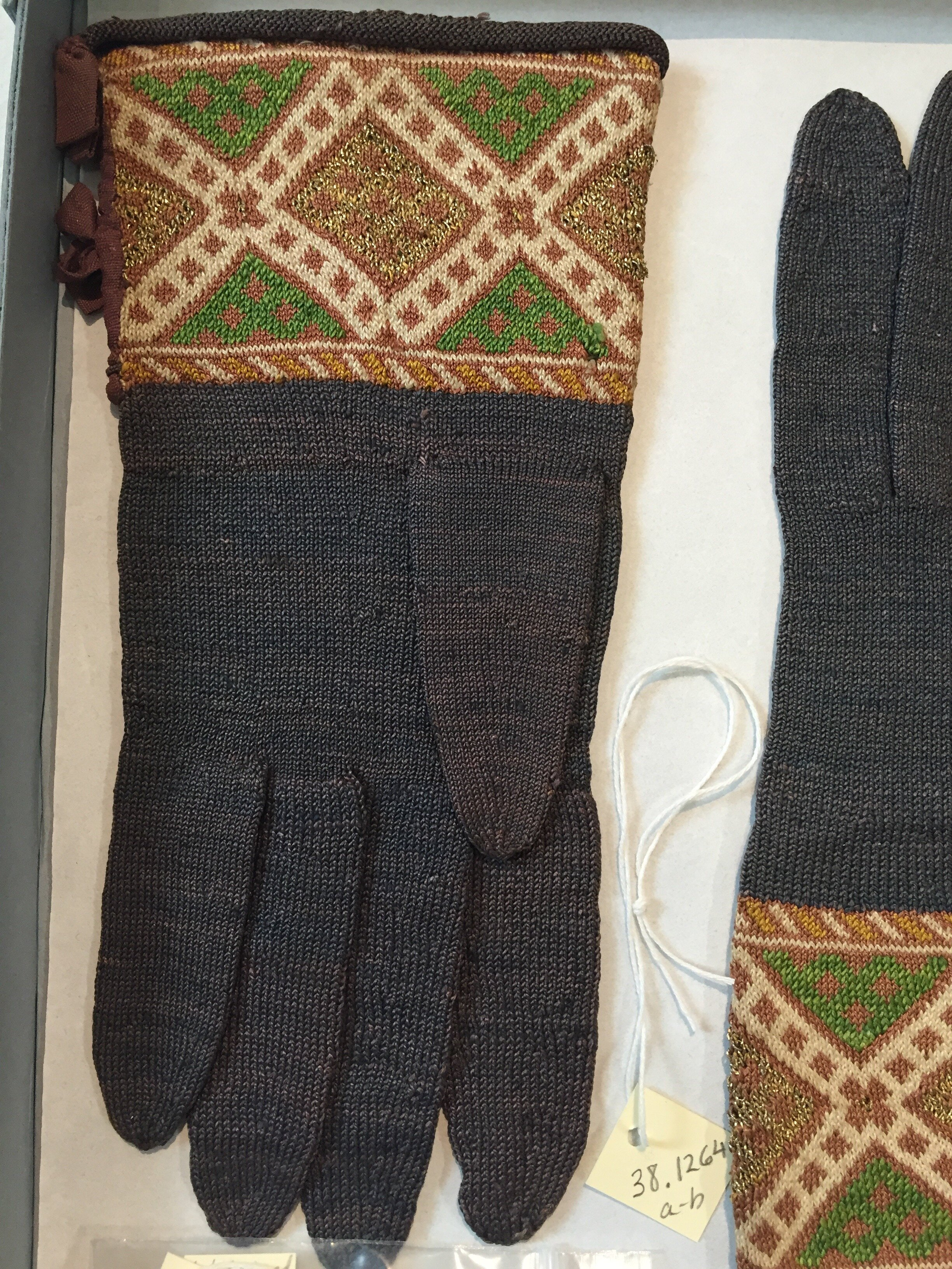 A pair of silk and metallic gloves in the Boston Museum of Fine Arts, Mid-17th century. In the cuff, there are a minimum of 3 colors used at a time with an additional 4th color periodically.