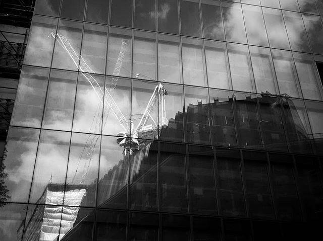 Just playing with a bit of #blackandwhitephotography on the #samsunggalaxys7 whilst waiting around in #london #artystuff #reflections #buildingwork #towercrane
