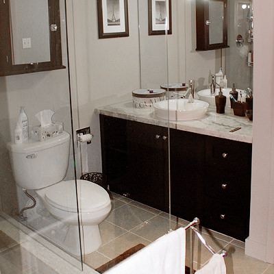GOOD THINGS IN SMALL(ER) PACKAGES  A bathroom doesn't need to be big to make a statement. Colours, lighting, mirrors and glass enclosures keeps things open and airy.