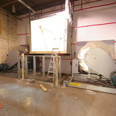 FROM WAREHOUSE TO WIND TUNNEL  On this project, we took an empty warehouse space and converted it into a  high-tech testing facility , complete with a wind tunnel and an air-conditioned data storage area.