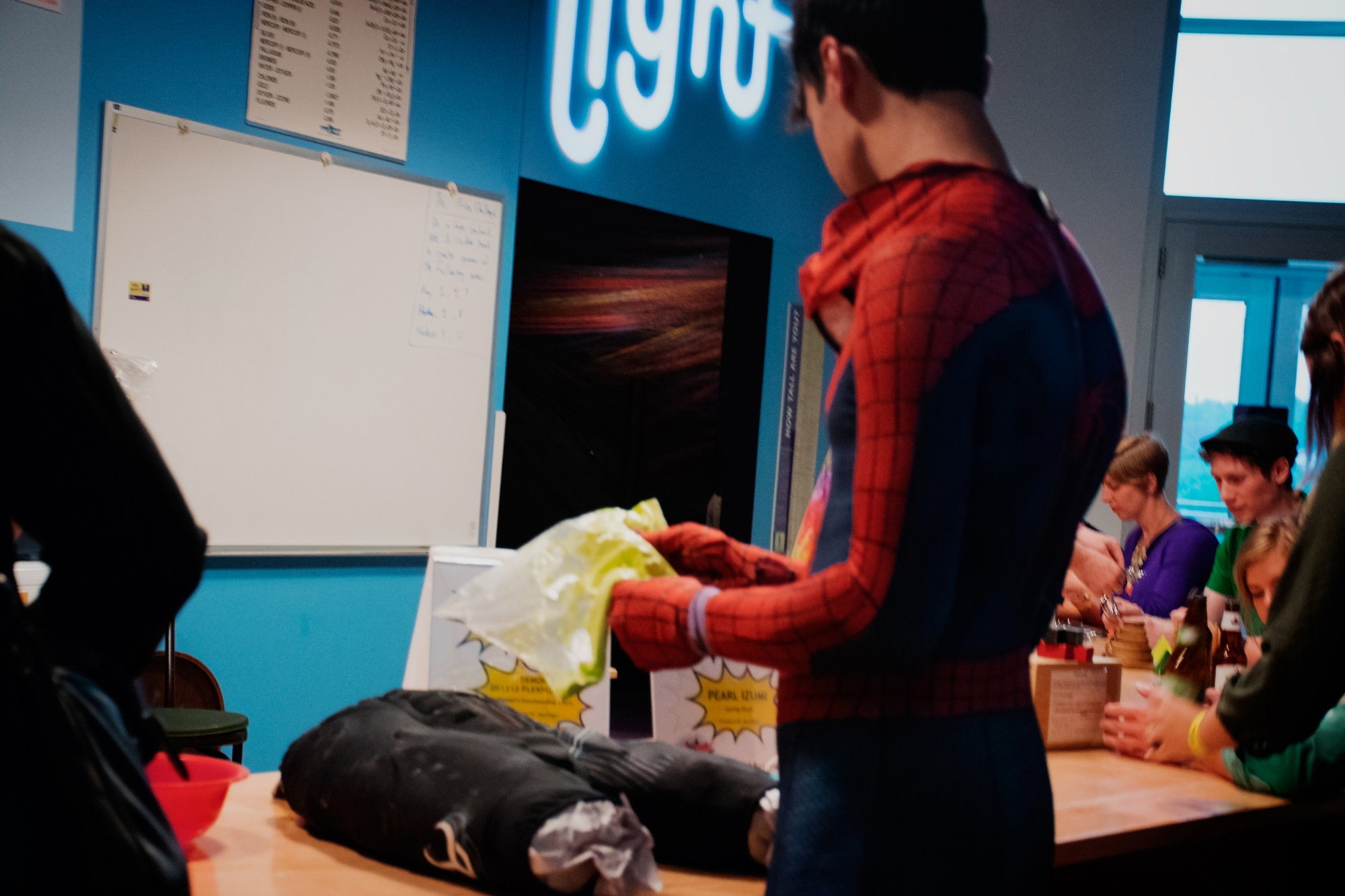 A curious Spiderman contemplates upgrading his spidey-suit.