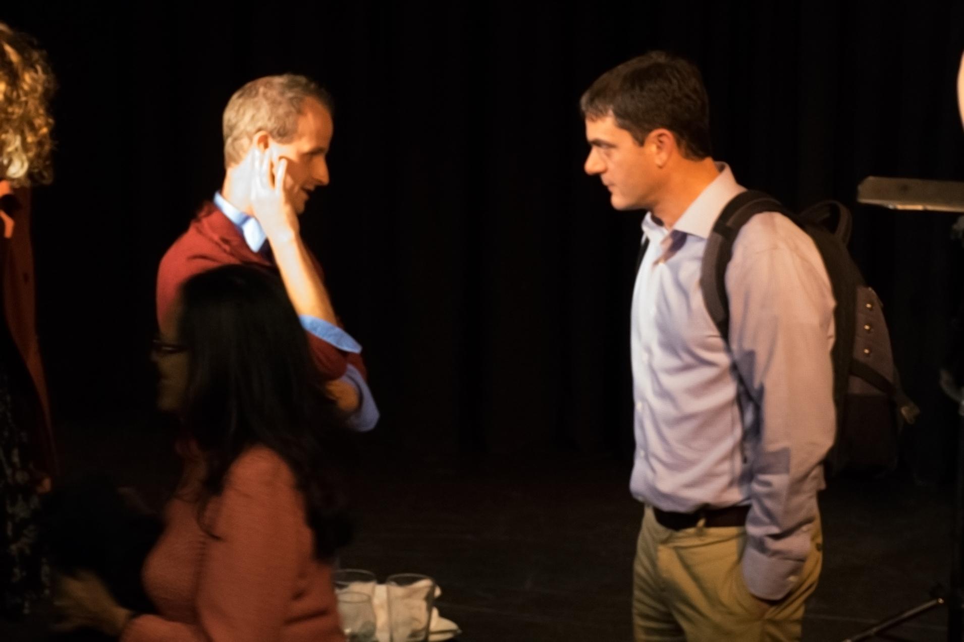 Dr. Adam Boyko speaks with an audience member