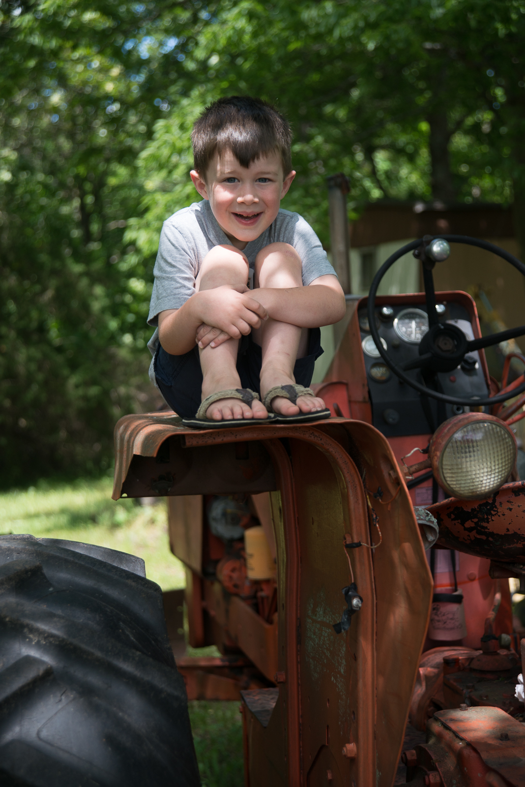 Aiden loves hanging out on GPa's tractor!