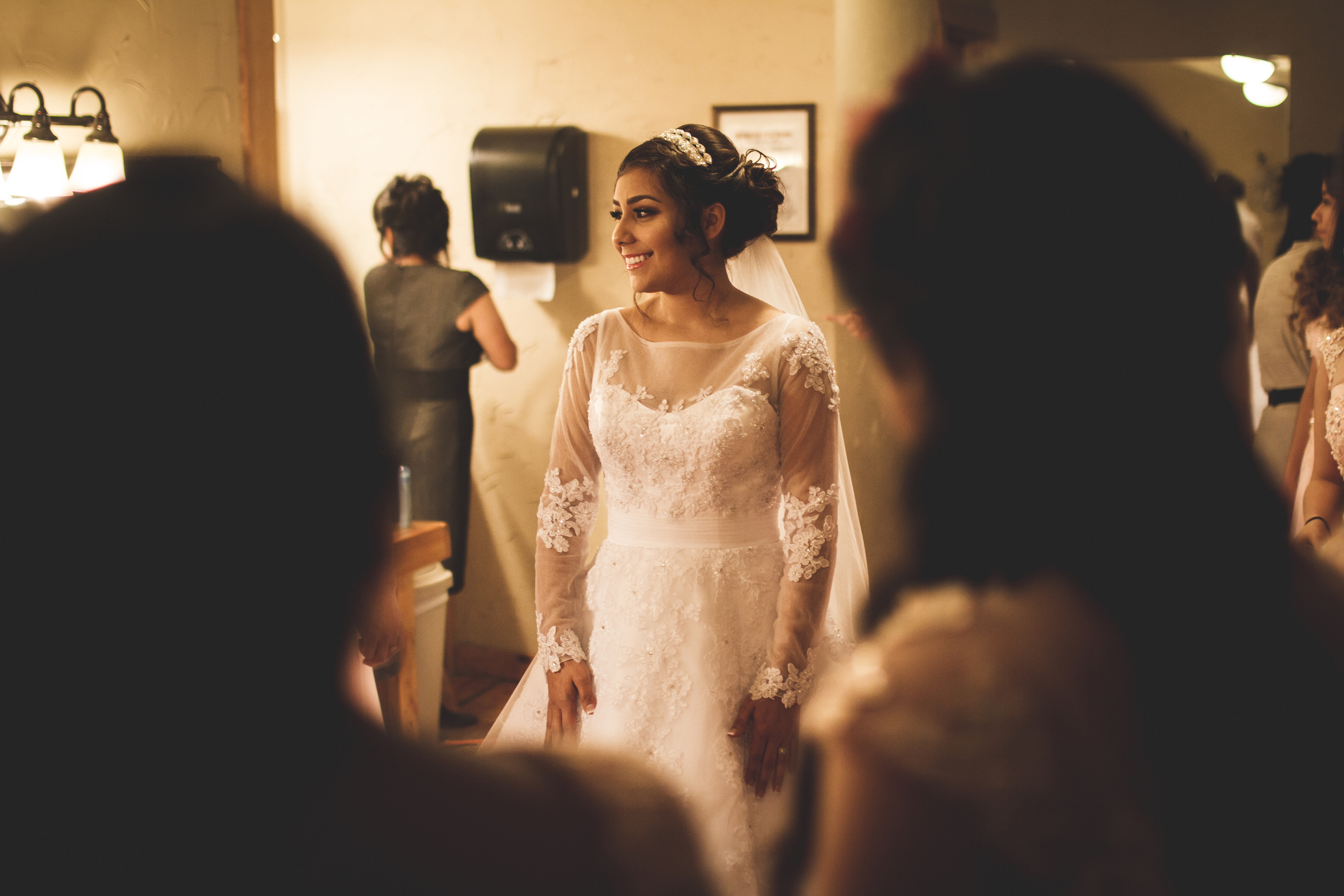 We had an amazing time traveling out to Kyle, Texas just south of Austin to shoot this lovely wedding. This is one of my favorite movements I captured right as Crystal saw herself in her dress for the first time on the day of her wedding.