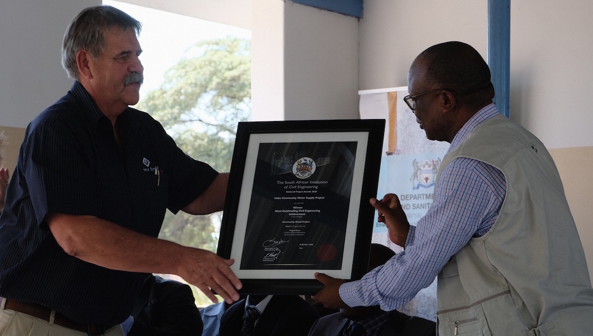 Framed copies of the award certificate were presented to Mr. Keemisetswe Khootla, the Assistant Chief and Headman of Arbitration in Habu; and to Dr Obakeng.