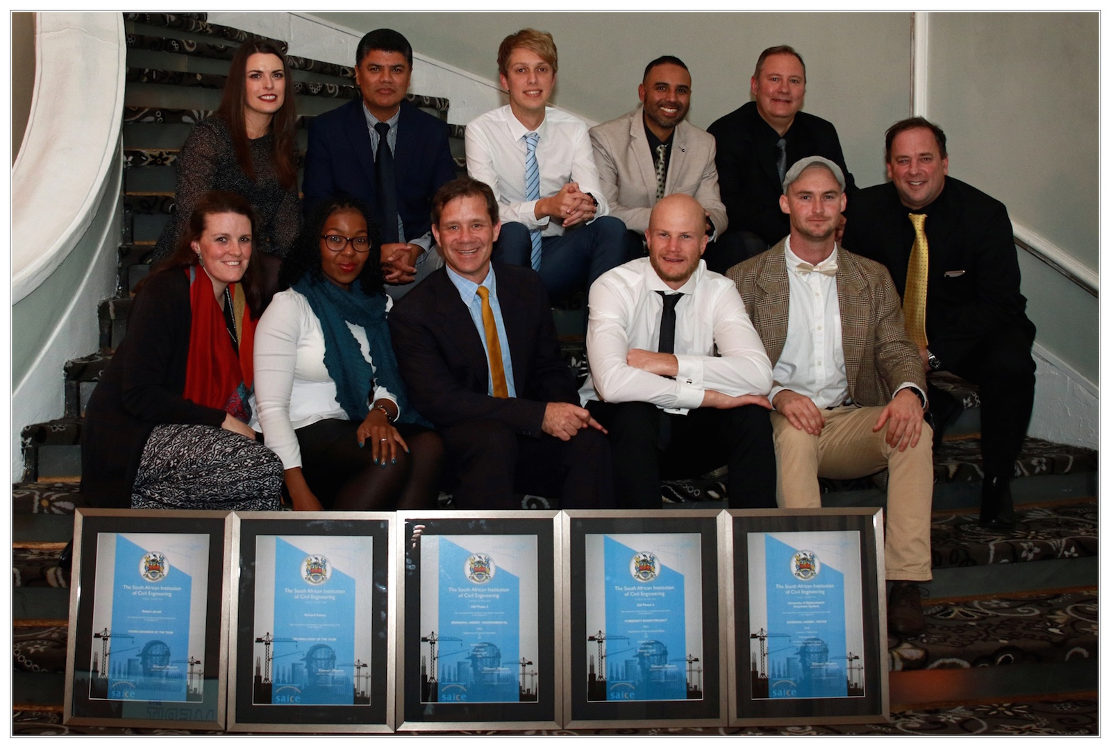 JG Afrika's winning team …. Back row: Terri-Ann Kruger, Owen Davis , Byron Mawer, Fareed Ismail and Wimpie Krügel. Front row: Viola Milner, Zama Mdlalose, Richard Emery, Bobby Jarratt, Benjamin Biggs, Andrew Clothier.