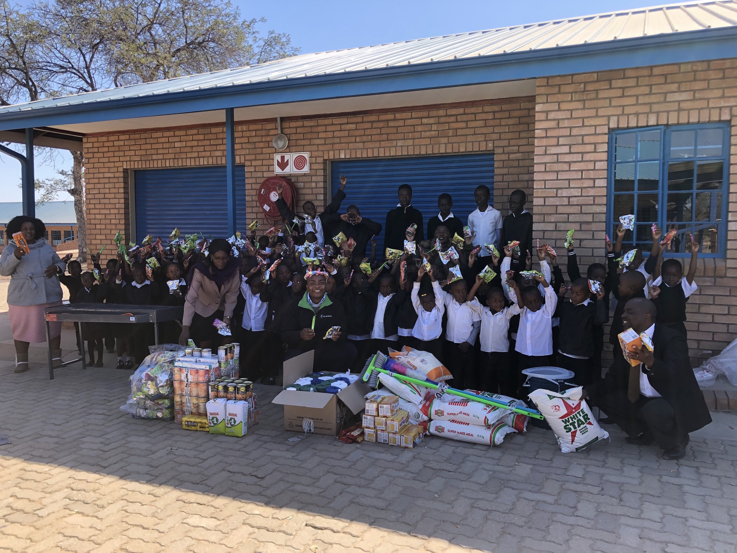 It was a joyous occasion when Pilusa arrived bearing bags of groceries collected by the firm's Johannesburg staff on Mandela Day.