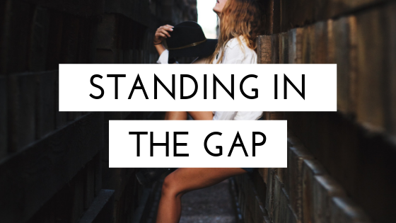 Woman Standing in the Gap.png