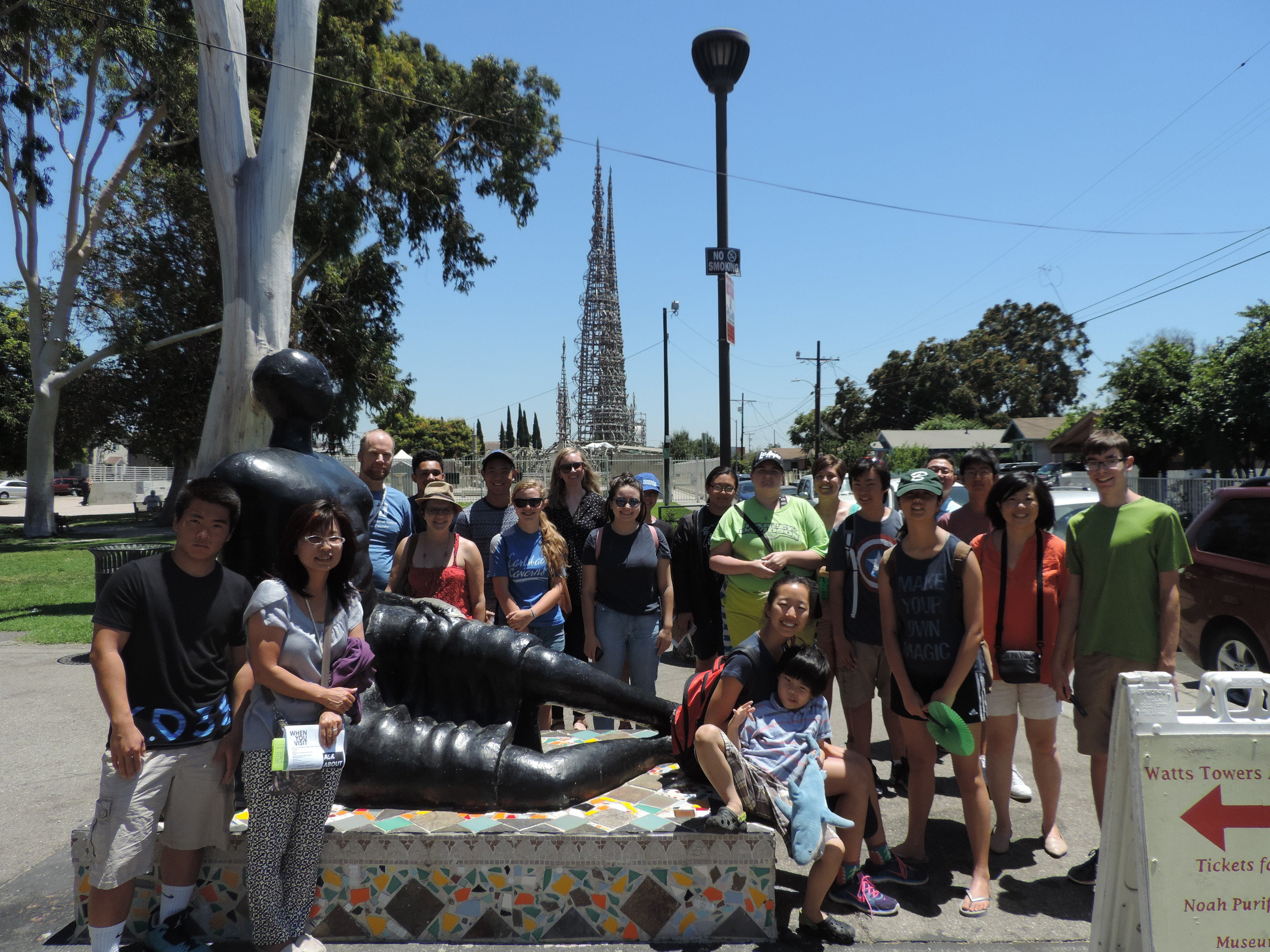 A group photo in front of the Watts Tower in South Central Los Angeles learning about the rich history of LA