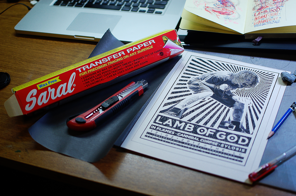 My workspace complete with reference shot, Saral transfer paper roll, and trusty ballpoint pen.