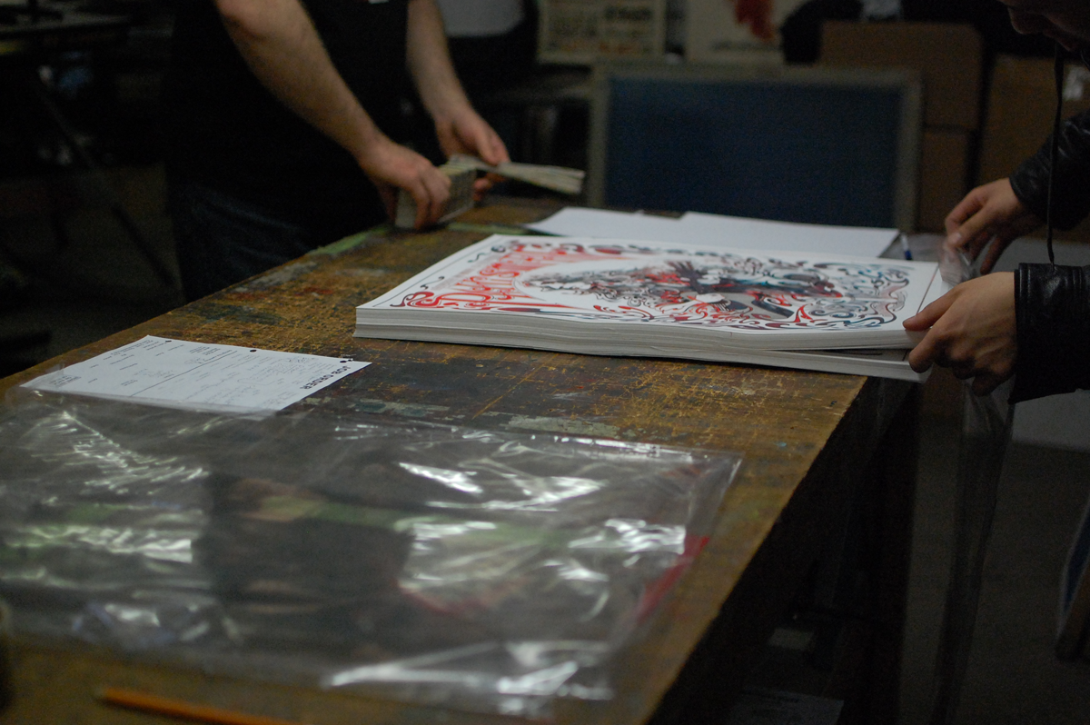 Re-packing the posters for safe transport home.