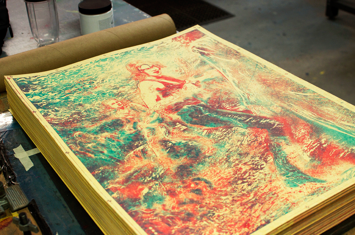 A stack of prints after two colours were laid down.