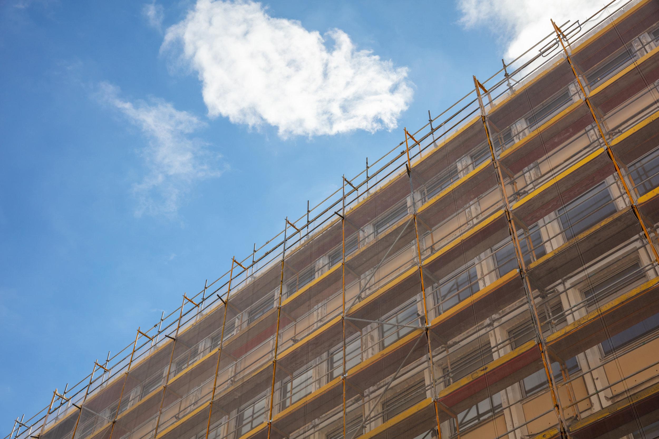 building-construction-with-scaffolding-blue-sky-B57P8X4.jpg