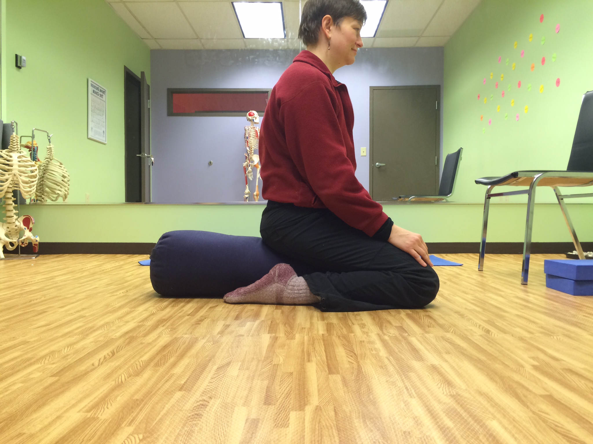 Stretch your quads! If you don't have a yoga bolster you could also use a couple of pillows.