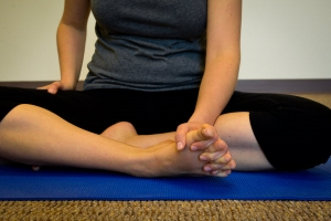 2. Gently stretch your toes apart by placing your fingers in between your toes
