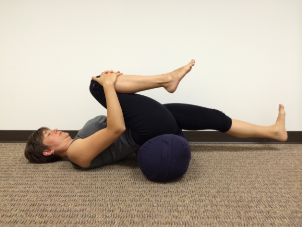 Hip Flexor Stretch - prop your pelvis up on a bolster, rolled up blanket or sleeping back. Bring your knee to chest and extend your opposite leg out with a straight knee. This will create a stretch through the front of the hip joint, where the hip flexors cross.
