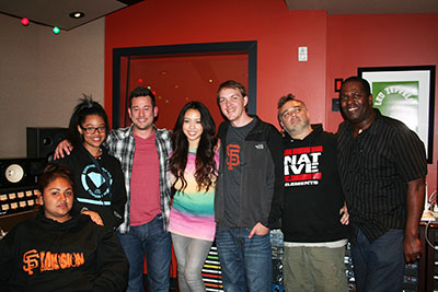 Pictured (L-R) at Studio Trilogy are students Mariacel Gutierrez and Kianna Farr-Zunig, FYR founder Jason Wall, singer Thia Megia, engineer Tyler Crowder, songwriter/producer Ben Thompson, and composer/producer/multi-instrumentalist Mo Pleasure.