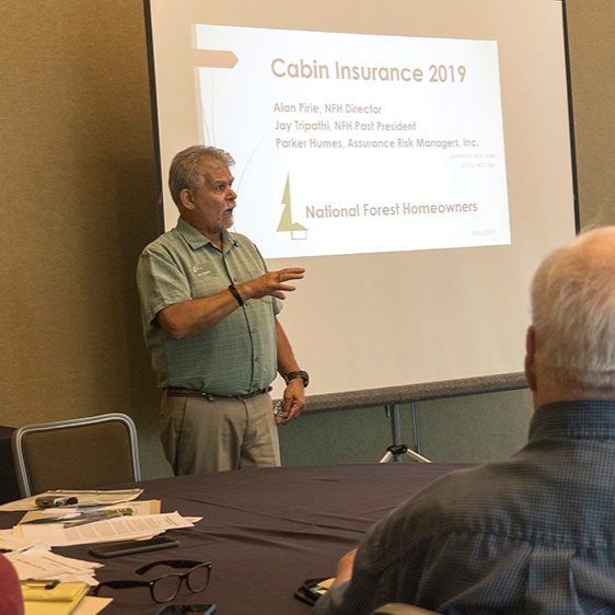 Jay Tripathi, NFH Past President, discussing NFH Cabin Insurance Program (Source: National Forest Homeowners)