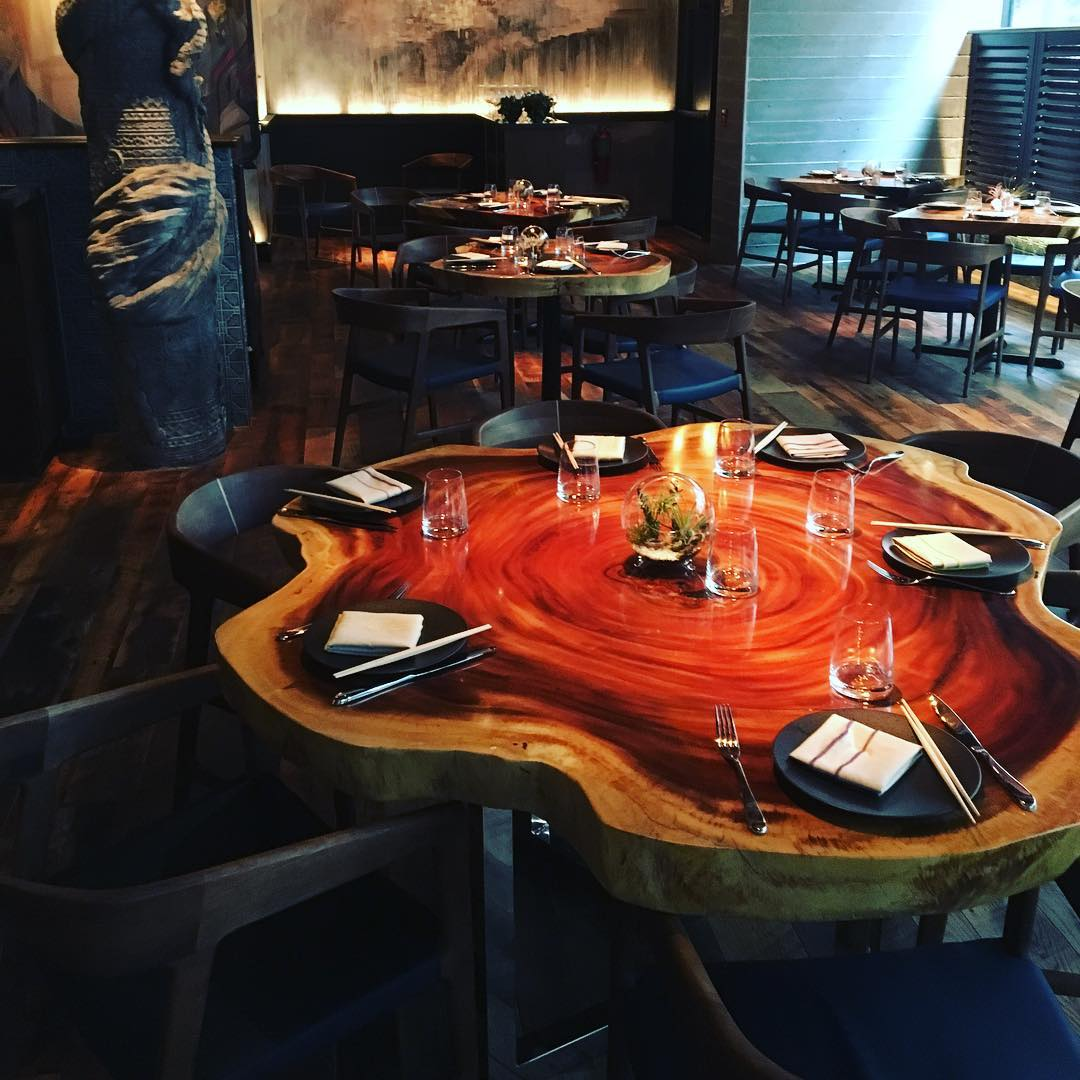 "60"" round cross-cut golden acacia - One of 30 custom built tables for Ruka in Boston"